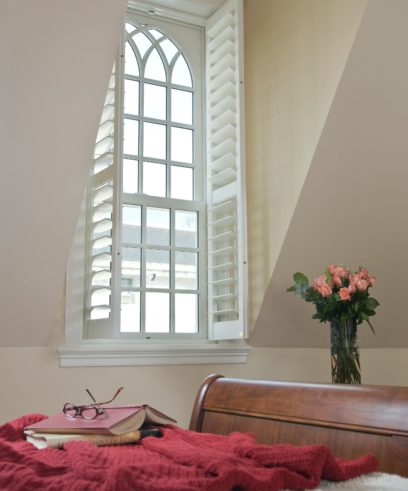 Room 135 - Coral Mahal - - Vignette with open shutters and book on bed