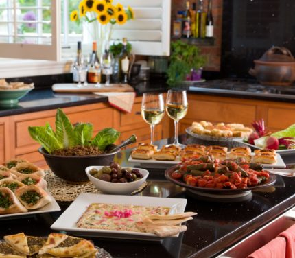 An incredible spread of homemade hors d'oeuvres sits on the kitchen island