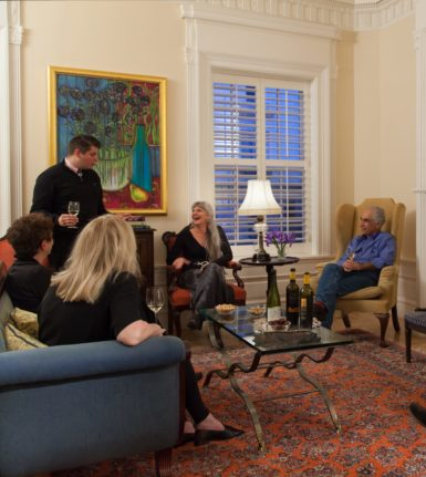 Embassy Circle - Guests gather in the main living area for Wine Time.